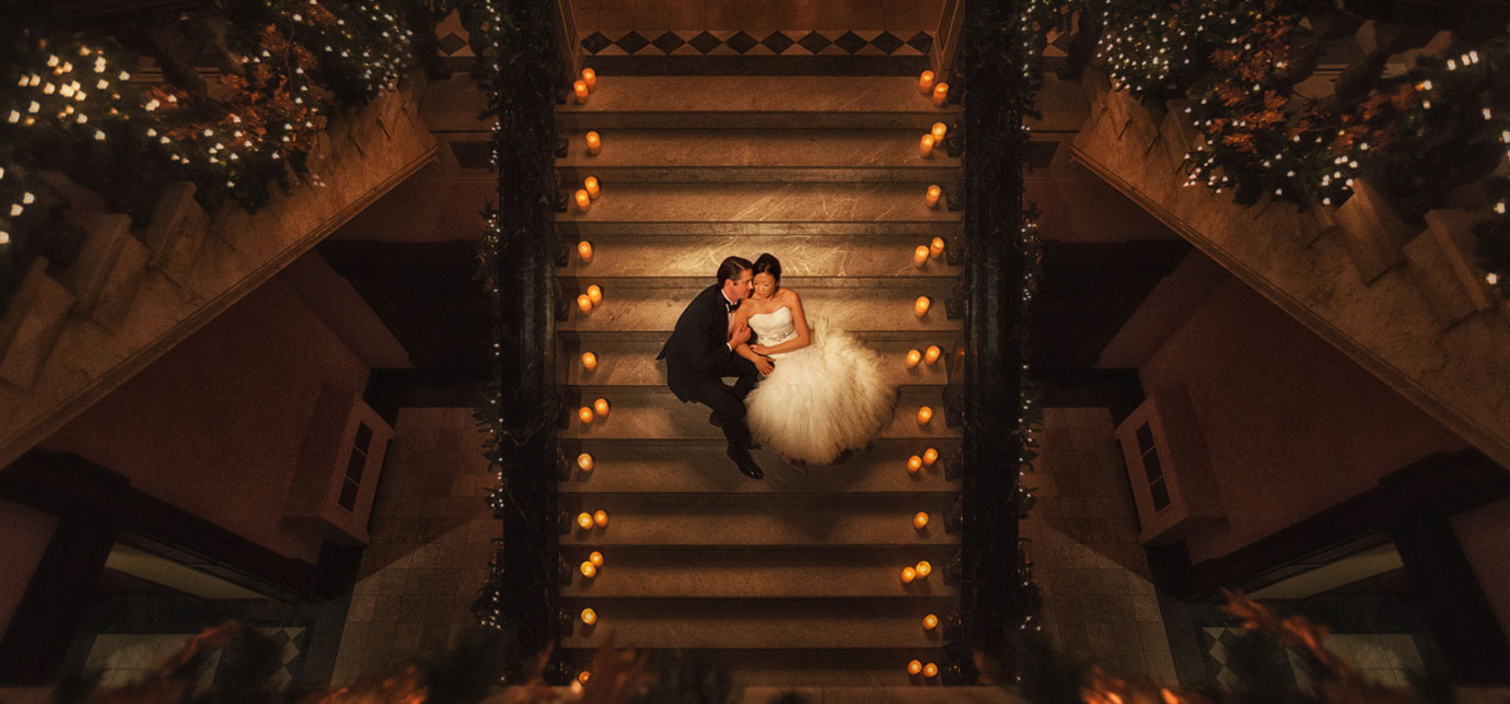 Wedding portrait on grand staircase at Charleston wedding